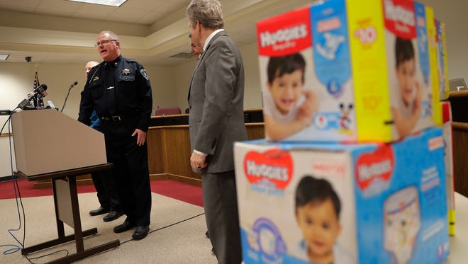 Fox Crossing Police Chief Tim Seaver speaks during a press conference about the arrest of two men connected with the theft of diapers from the Fox Cities Diaper Bank on Tuesday at the Fox Crossing Police Department.