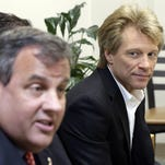 Gov. Chris Christie (left) talks during an appearance with singer Jon Bon Jovi in 2013 at a drug rehab program in Paterson. (file photo)