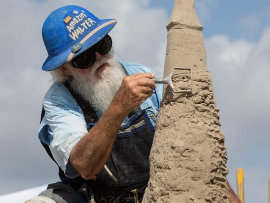 Walter McDonald of South Padre Island constructs a sand sculpture in the master duo competition during Texas SandFest on Saturday, April 22, 2017, in Port Aransas. His partner, Christy McDonald Atkinson, is not pictured.