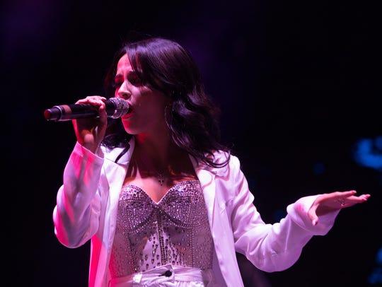 Becky G. preforms during Fiesta de La Flor on Saturday,