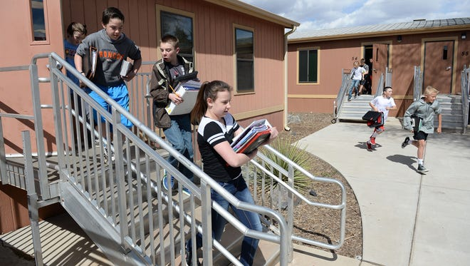 Wellington Middle School students leave classrooms in modular buildings Tuesday. Wellington is an area of focus for Poudre School District's Long Range Plan because of population growth in the north Larimer County town.