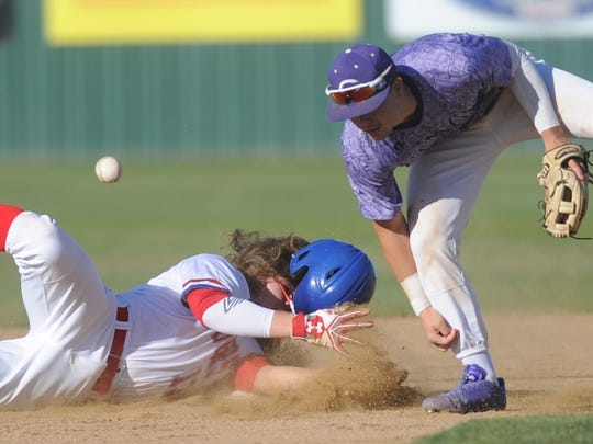 Cooper runner Zach Goodson, left, dives safely back into second base as Canyon second baseman Kason Haggard can't come up with the pickoff throw in the fourth inning. Freeman later scored on Terreon Paige's two-run triple in the inning. Canyon won Class 5A bi-district playoff game 14-3 Friday, May 5, 2017 at Lubbock High's Westerner Field to take a 1-0 lead in the best-of-three series.