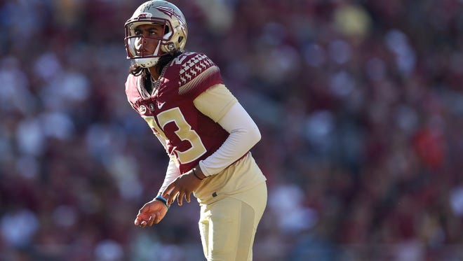 FSU's Ricky Aguayo sizes up a field goal against UNC during their game at Doak Campbell Stadium on Saturday.