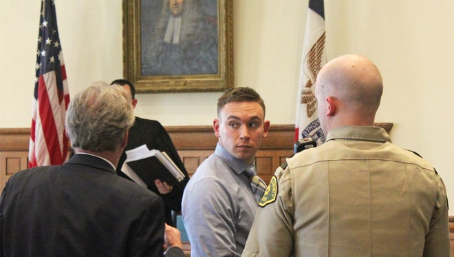 Nathan Schloss exits the courtroom Sept. 14, 2017, after receiving a 10-year prison sentence for assault causing serious injury and invasion of privacy. Schloss was accused of recording himself sexually abusing an incapacitated woman on multiple occasions.