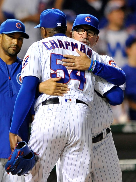 Chicago Cubs closing pitcher Aroldis Chapman (54) celebrates with manager Joe Maddon after defeating the Cincinnati Reds 5-2 during a baseball game Monday, Sept. 19, 2016, in Chicago. (AP Photo/Paul Beaty)