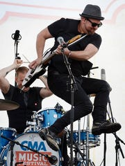 Kristian Bush performs at the Riverfront stage during