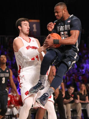 Georgetown's Jabril Trawick (55) and Wisconsin's Frank Kaminsky (44) fight for the ball during their game in the Battle 4 Atlantis basketball tournament in Paradise Island, Bahamas, on Thursday.