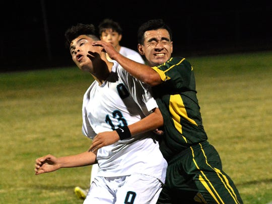Oñate's Josue Sanchez, left, and Mayfield's Carlos