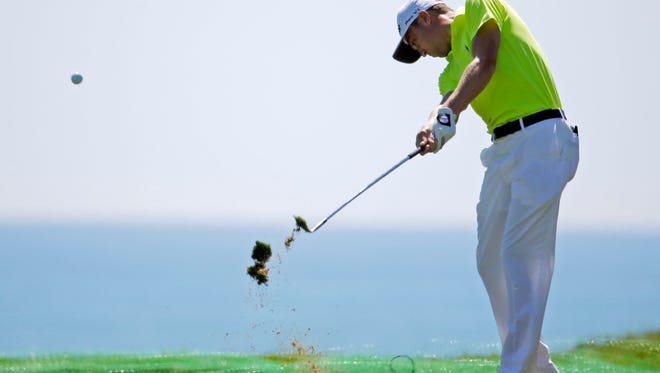 Justin Thomas hits a shot on the 12th hole during a practice round for the PGA Championship golf tournament Tuesday, Aug. 11, 2015, at Whistling Straits in Haven, Wis. (AP Photo/Chris Carlson)