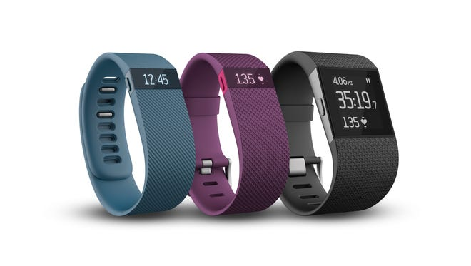 Fitbit's new activity trackers. The Surge is on right