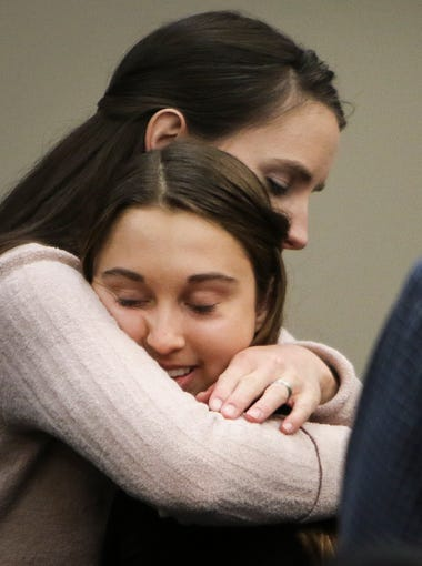 Seventeen-year-old Stephanie Robinson hugs Rachael Denhollander Wednesday, Jan. 17, 2018, after Robinson went public in Circuit Judge Rosemarie Aquilina's courtroom during the second day of victim impact statements regarding former sports medicine doctor Larry Nassar, who pled guilty to seven counts of sexual assault in Ingham County, and three in Eaton County.