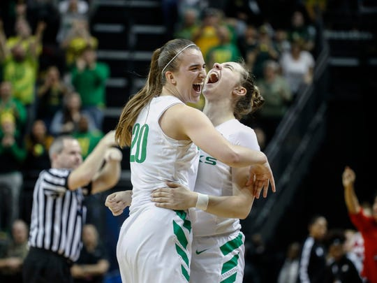 Oregon guard Sabrina Ionescu (20) celebrates with guard Morgan Yaeger (2) in the closing moments against Indiana during a second-round game of the NCAA women's college basketball tournament Sunday, March 24, 2019, in Eugene, Ore. Oregon won 91-68. (AP Photo/Thomas Boyd)