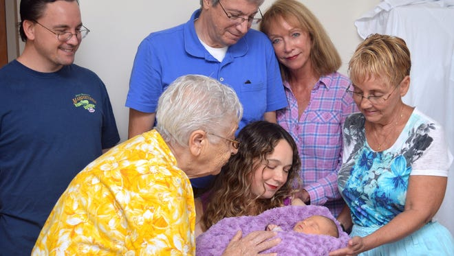 This photo was taken the day after Isabella was born, July 11, 2014. Pictured with my wife, Isabella and I are my mom, right, mother-in-law, second right, father-in-law and grandmother.