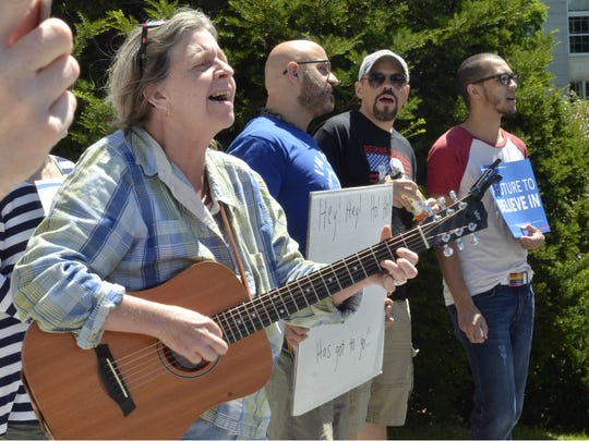 Donna Joerg of Jeffersonville, left, leads participants in a rally in song on Sunday on the steps of the Vermont Statehouse in Montpelier. The rally was held to thank and further support U.S. Sen. Bernie Sanders in his bid for president.
