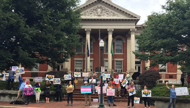 Citizens rally for transgender rights and health care in front of the Augusta County Courthouse in Staunton, Va., on Saturday, July 29, 2017.