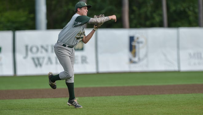 Third baseman Hunter Tabb (16) throws the runner out at first as the  Lafayette Lions Meet the Acadiana Rams for game 3 of second round playoff game at Tigue Moore field.