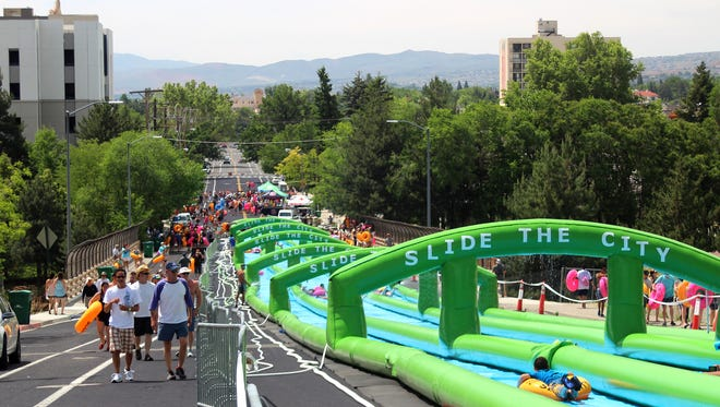 A 1,000-foot long water slide from Slide the City will take over Nyack's Main Street Aug. 27, 2016. This photo shows a similar recent event in Reno, Nevada.