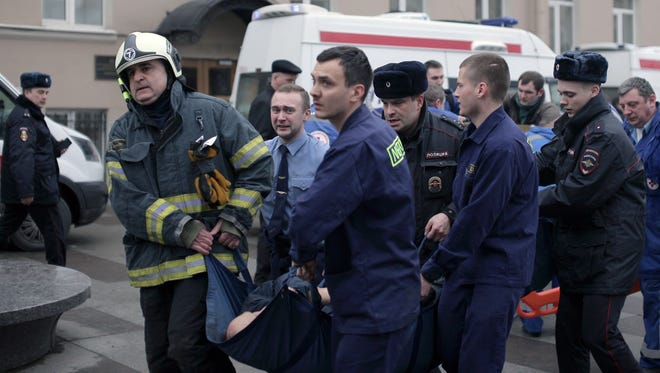 Police and emergency services personnel carry an injured person on a stretcher outside Technological Institute metro station in Saint Petersburg, on April 3, 2017. Around 10 people were feared dead and dozens injured after an explosion rocked the metro system in Russia's second city Saint Petersburg, according to authorities, who were not ruling out a terror attack.