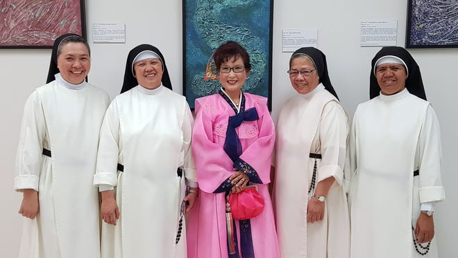 On June 8, local artists presented two-dimensional artwork for the Moving Colors, Series 4 Chamorro Seascapes at CAHA art gallery. More than two dozen paintings were from residents of St. Dominic's Senior Care Home. Pictured from left: Sister Teresita Manaloto, OP Sister Victoria Cambronero, OP, Yeon Sook Park, Sister Ursula Apacionado,OP and Sister Bernardita delos Reyes, OP from St. Dominic Senior Care Home in Barrigada Heights.