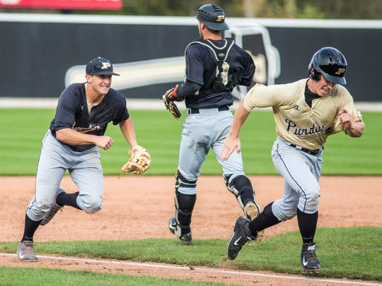 Purdue infield Logan Poisall, left, shown here during