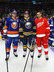John Tavares  of the New York Islanders, Kyle Okposo of the Buffalo Sabres and Frans Nielsen of the Detroit Red Wings pose for a photo during the Gatorade NHL Skills Challenge Relay during the 2017 Coors Light NHL All-Star Skills Competition as part of the 2017 NHL All-Star Weekend at Staples Center on Jan. 28, 2017 in Los Angeles.