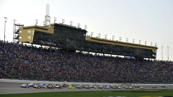 Drivers take the green flag to start a NASCAR Cup Series race at Kansas Speedway in 2018. NASCAR will race at the Speedway July 23-25 without fans in attendance.
