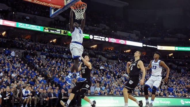 Creighton Bluejays guard Khyri Thomas (2) dunks against Butler Bulldogs guard Sean McDermott (22) at CenturyLink Center Omaha on Jan. 11.