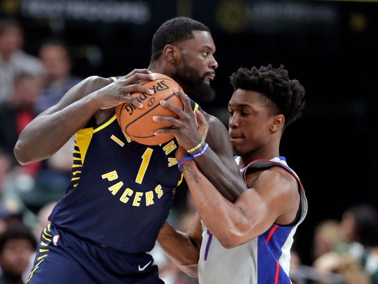 Pistons forward Stanley Johnson (7) fouls Pacers guard