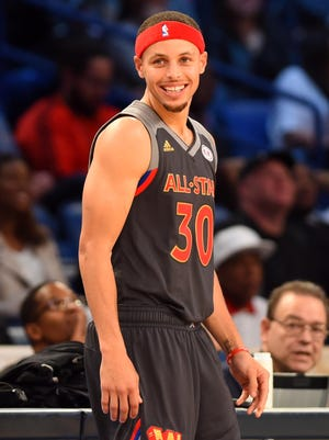 Western Conference guard Stephen Curry of the Golden State Warriors (30) smiles on the court in the 2017 NBA All-Star Game.