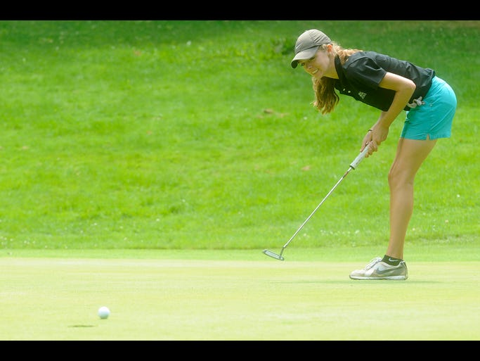 Lauren Keiser reacts as her putt falls just short of the cup during the final event of the season for the Licking County Junior Golf Association on Wednesday, July, 30, 2014 at the Links at Eachosprings.