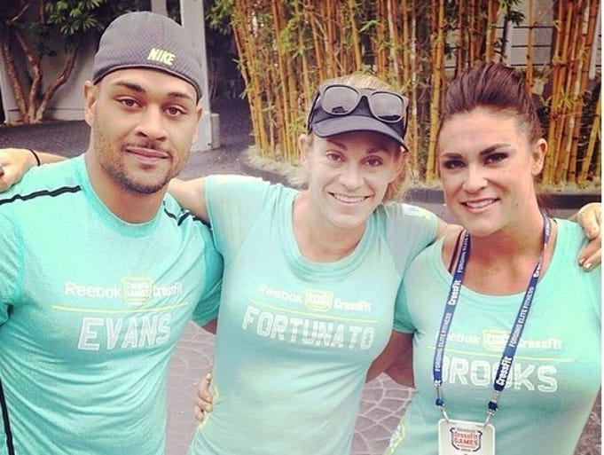 Jeff Evans, Talayna Fortunato and Lauren Brooks stop for a picture Friday during the CrossFit Games in Carson, Calif. The trio, from Fort Myers, Naples and Cape Coral, respectively, represented Southwest Florida in the international competition.