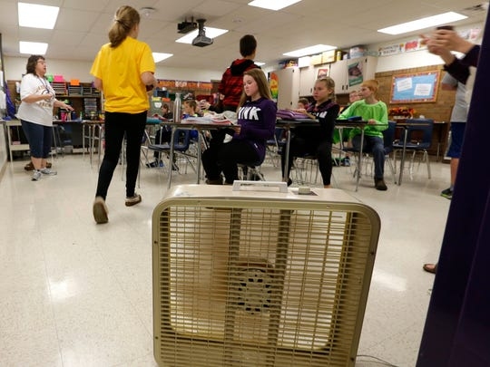 Teacher Connie Lichtenwalb keeps fans running constantly in her class room in the Kiel School District. The district has rejected several referendum attempts to raise money for the district beyond limits set by the state.