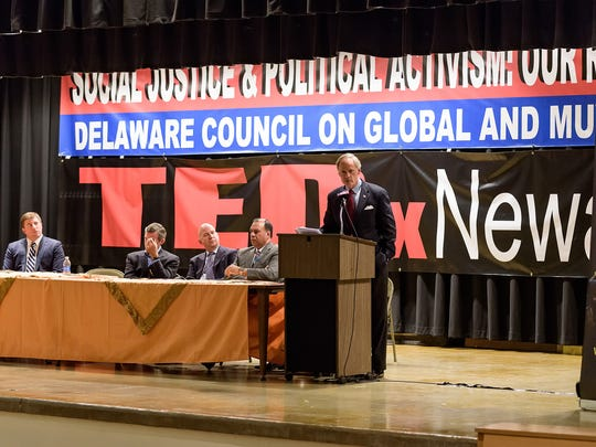 Senator Tom Carper makes remarks during the  Muslim Community Convention on Social Justice and Political Activism hosted by the Delaware Council on Global and Muslim Affairs at the Gauger-Cobbs Middle School in Newark on Saturday.