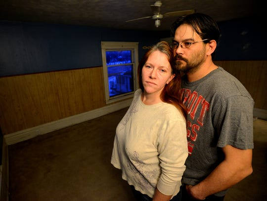 Stephanie and Ted Jezowski stand in an empty room in