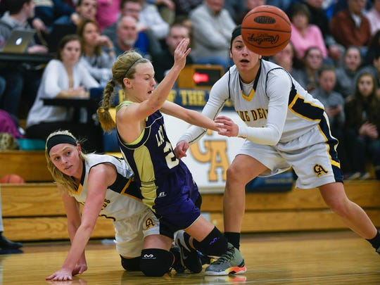 Jenay Faulkner goes to block a pass that was to Chloe Hostetter of Boiling Springs, Hostetter trips over Hannah Crist of Greencastastle during a girls basketball game in Greencastle, Pa. on Feb. 4, 2016. Greencastle defeated Boiling Springs 50-48.