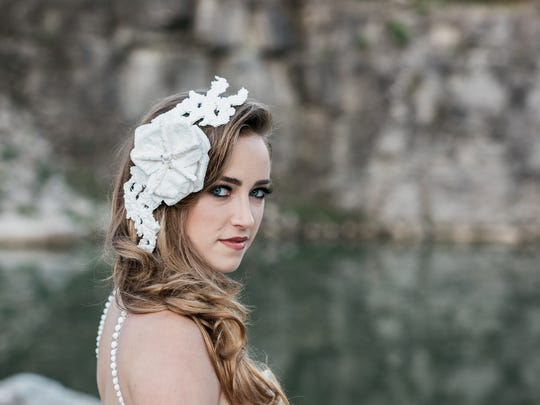 A model wears a headpiece created by Donna Pope Vincler, a Brentwood woman seeking to repeat as the winner of a toilet paper wedding dress contest.