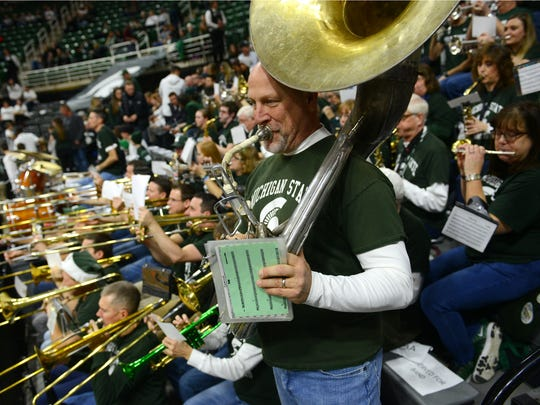 Jim Niebling of the Alumni Band plays before the game against Northwestern on Friday, Dec. 30, 2016, at Breslin Center.