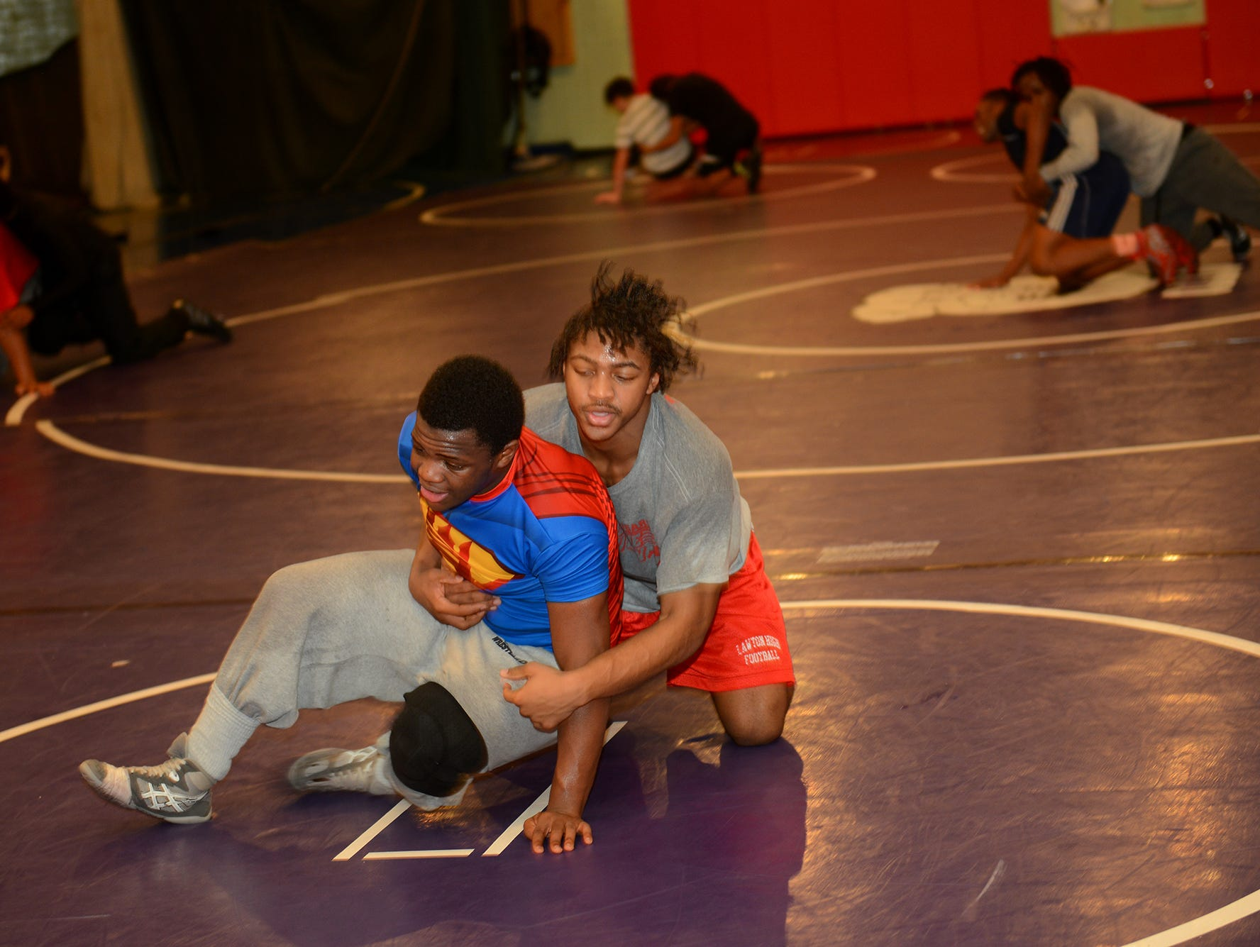 Wrestlers Elijah Stevenson, left, and Ratavian Rinkines warm up with sprints on Tuesday, Feb. 7, 2017 at Sexton High School.