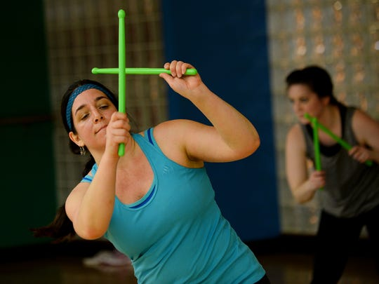 Julianne Daher works out in the Pound class on Wednesday, May 17, 2017 at the Downtown YMCA Wellness Center in Lansing. Pound is a workout inspired by drumming.