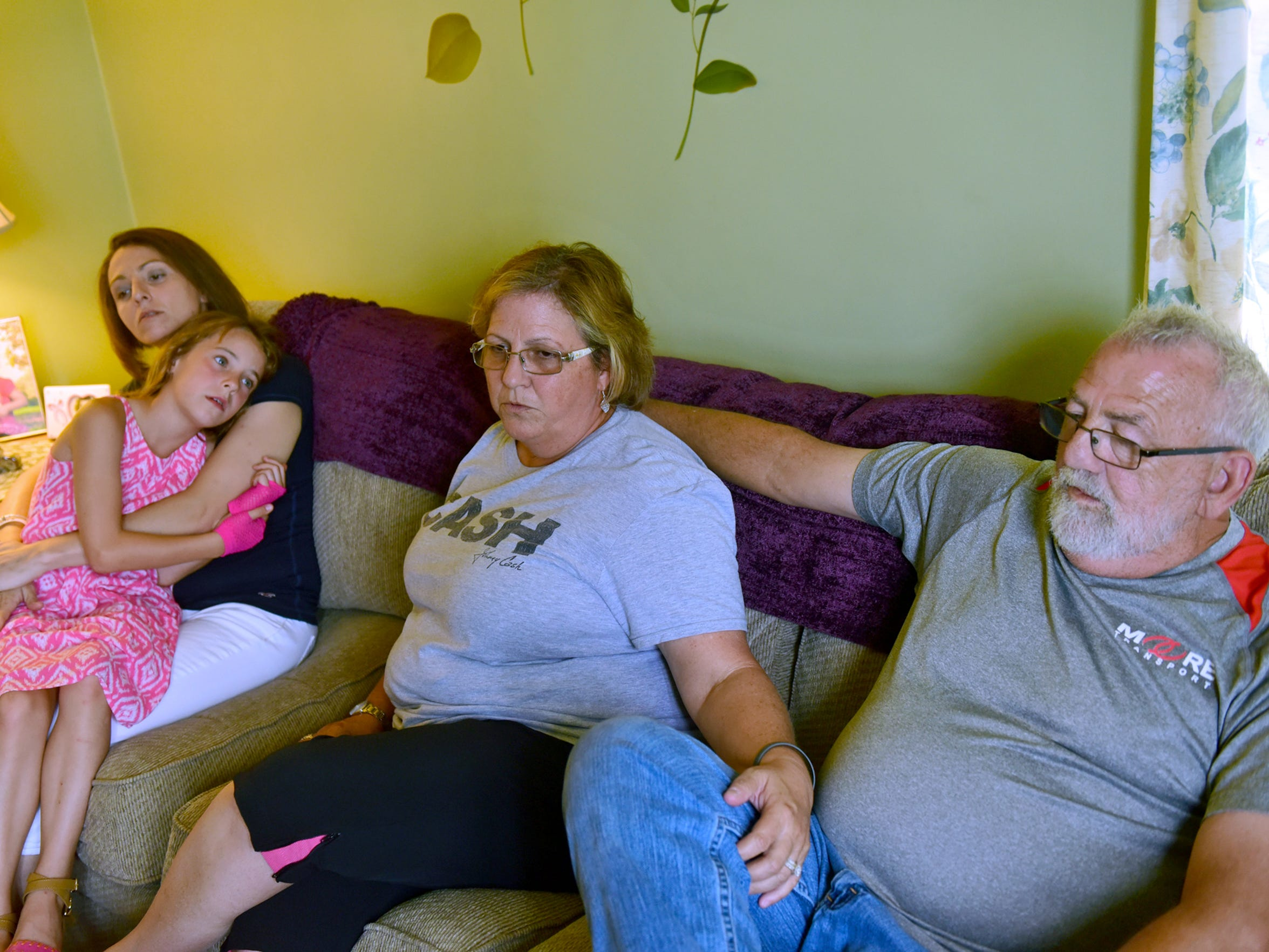 Staci Harrison, left,  holds her daughter Lela, 7,  as she spends time with her parents Mike and Sue Harrison of Marion. Staci Harrison battled addiction for a decade and is embracing recovery.