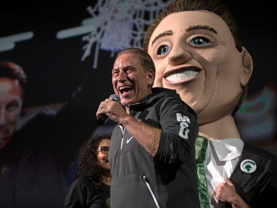 Michigan State University head coach Tom Izzo speaks to the crowd as a bobble-head version of himself stands in the background during the annual Midnight Madness event on Friday, Oct. 20, 2017, at the Breslin Center in East Lansing.
