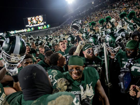 The Michigan State Spartans celebrate after beating Penn State 27-24 on Saturday, November 4, 2017, at Spartan Stadium in East Lansing.