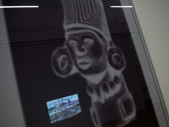 A video is reflected in a digital print as part of