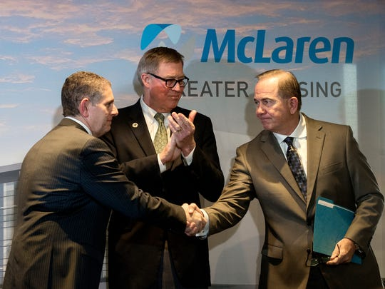 Lansing Mayor Virg Bernero, left, shakes hands with