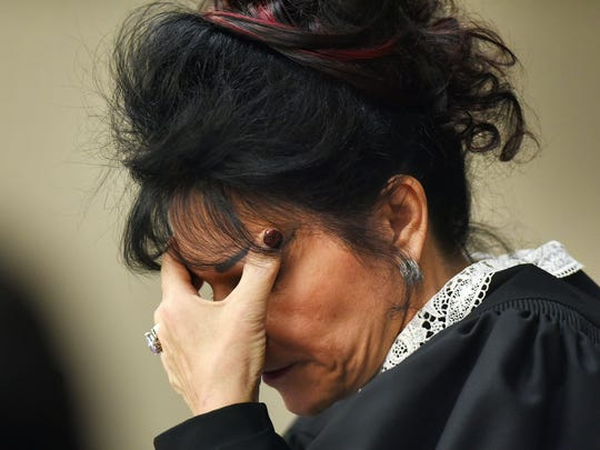 Ingham County (Mich.) Circuit Judge Rosemarie Aquilina reacts while listening to victim statements Monday, Jan. 22, 2018, the fifth day of victim-impact statements against Larry Nassar in Ingham County Circuit Court in Lansing, Mich.