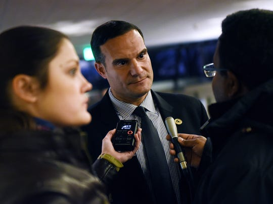 Michigan State University Trustee Brian Mosallam talks with media before a town hall meeting on Thursday, Feb. 1, 2018, at the Kellogg Center on the MSU campus in East Lansing.