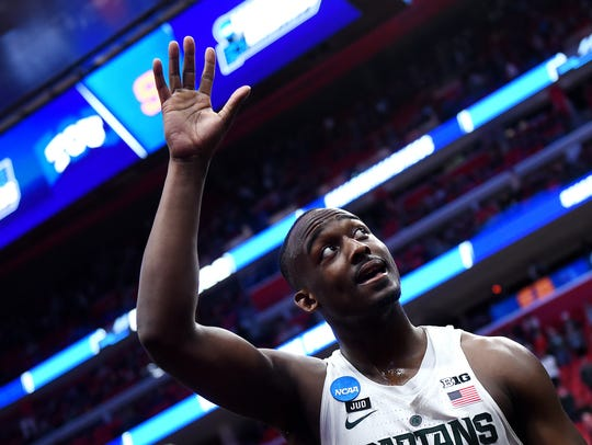 Michigan State's Joshua Langford waves to fans while