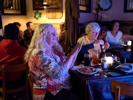 Maggie Godward, left, and Deborah J. Sutherland listen