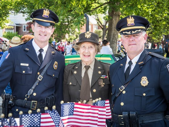 In 2010, Grand Marshal Beverly Rosenstein with Lt. Sean Smith and Chief Robert Francaviglia at the Hillsdale Memorial Day Parade..