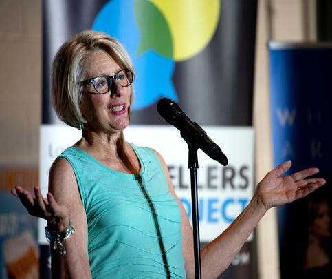 Karen Jennings speaks during the Lansing Storytellers Project: 'Water' event on Tuesday, July 17, 2018, at the Lansing Brewing Company in Lansing.